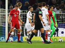Thomas Müller (l.) bejubelt seinen goldenen Treffer gegen Gladbach
