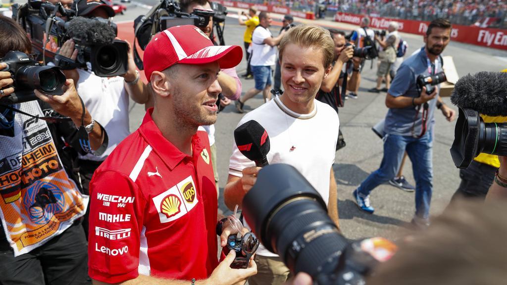 Nico Rosberg (r.) traut Sebastian Vettel eine Karriere bei Mercedes zu