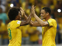 Willian y Ricardo Oliveira fueron los goleadores de Brasil. (Foto: ProShots)