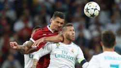 """Dejan Lovren (l.) und sein """"spezieller Freund"""" Sergio Ramos"""
