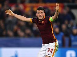 Alessandro Florenzi is het niet eens met de beslissing van de scheidsrechter tijdens het Champions League-duel AS Roma - Real Madrid. (17-02-2016)