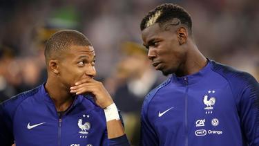 Mbappé y Pogba conversan antes de un duelo ante Alemania. (Foto: Getty)