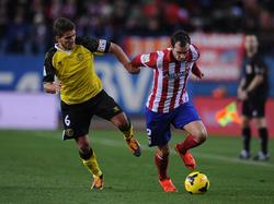 Daniel Carriço (l.) im Spiel gegen  Atlético Madrid