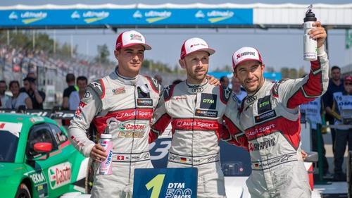 In Feierlaune: Die Audi-Piloten René Rast (M) , Nico Müller (l) und Mike Rockenfeller