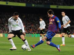 Im Duell gegen Lionel Messi
