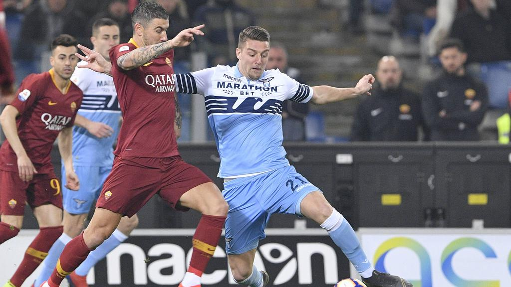 ... Ciro Immobile scored as Lazio beat Roma 3-0 in the capital-city derby  on Saturday to revive their hopes of Champions League qualification from Serie  A. 120f1bbbc5ff8