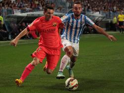 Sergi Darder versucht Lionel Messi zu stoppen