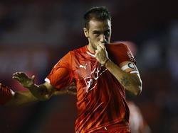 Mancuello celebra un gol con la camiseta de Independiente en un choque contra Belgrano. (Foto: Imago)