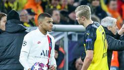 Kylian Mbappé von PSG und Erling Haaland (r.) vom BVB sollen das Interesse von Real Madrid geweckt haben