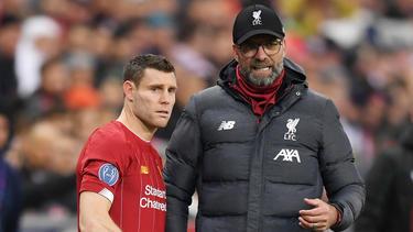 Verlängern beide in Liverpool: James Milner (l.) und Jürgen Klopp (r.)