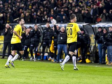 Kevin Brands (r.) zoekt samen met Kenny van der Weg het thuispubliek op na de 3-0 tegen FC Eindhoven. Brands schiet met ietwat geluk de derde treffer binnen. (18-01-2016)