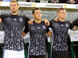 Toni Kroos, Mesut Özil  y Manuel Neuer de derecha a izquierda. (Foto: Imago)