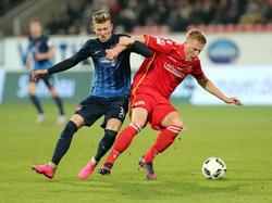 Tim Skarke (l.) hat seinen Vertrag in Heidenheim vorzeitig verlängert