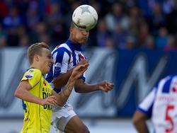 Marcel Ritzmaier (l.) in duel met Luciano Slagveer (r.) tijdens sc Heerenveen - SC Cambuur. (29-09-2013)