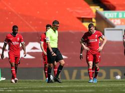 Hängende Köpfe bei Liverpool nach dem späten Punktverlust