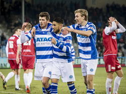 Santy Hulst (l.), Caner Çavlan (m.) en Vincent Vermeij (r.) vieren de 3-1 tijdens De Graafschap - MVV Maastricht. (13-02-2015)