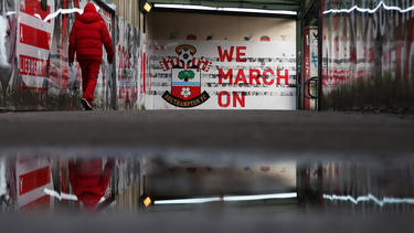 A fan makes their way to the stadium prior to the Premier League match between Southampton FC and West Ham United at St Mary's Stadium on December 14, 2019 in Southampton, United Kingdom.