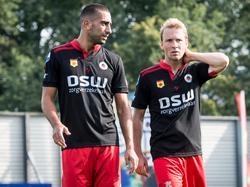 Adil Auassar (l.) en Rick Kruys (r.) druipen teleurgesteld af na afloop van het competitieduel Excelsior - Ajax. (20-09-2015)