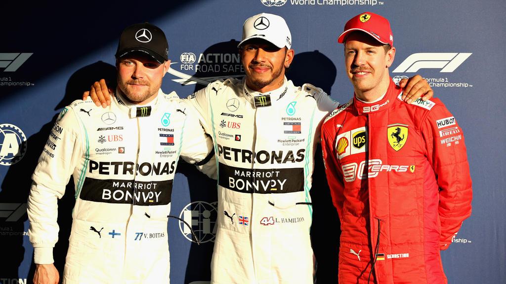 Sebastian Vettel (r.) startet nur von Platz 3