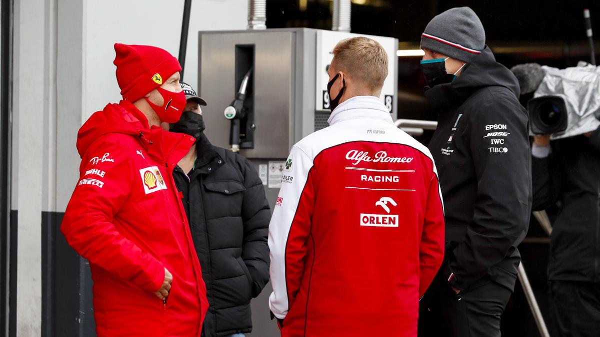 Sebastian Vettel (l.) und Mick Schumacher (2.v.r.) waren zum Zuschauen gezwungen
