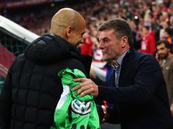 Die Cheftrainer von Bayern München und dem VfL Wolfsburg: Pep Guardiola und Dieter Hecking