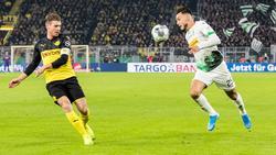 Gladbachs Ramy Bensebaini (r.) geht selbstbewusst in das Duell mit dem BVB