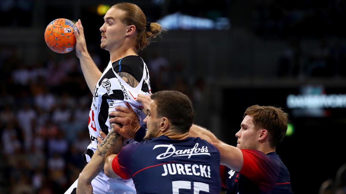 Michal Jurecki (l.) und der THW Kiel müssen nach Wetzlar
