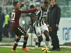 Juves Paul Pogba (r.) im Zweikampf mit Guiseppe Vives vom Torino FC