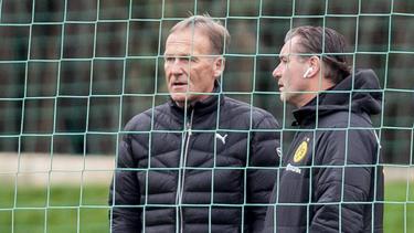 Hadern mit der BVB-Pleite gegen den 1. FC Köln: Aki Watzke (l.) und Michael Zorc