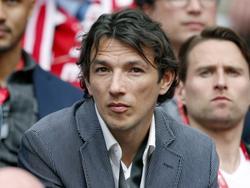 George Ogararu op de tribune van de Amsterdam Arena bij de competitiewedstrijd Ajax - FC Twente. Van 2006 tot 2010 stond de rechtsback bij Ajax onder contract. (30-03-2014)