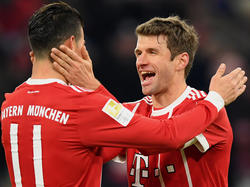 Thomas Müller (r.) ist von seinem Team begeistert