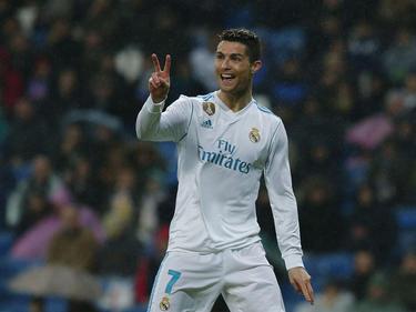 Ronaldo celebra su doblete bajo la lluvia de Madrid. (Foto: Getty)