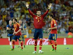 Piqué en un duelo con España en 2013.