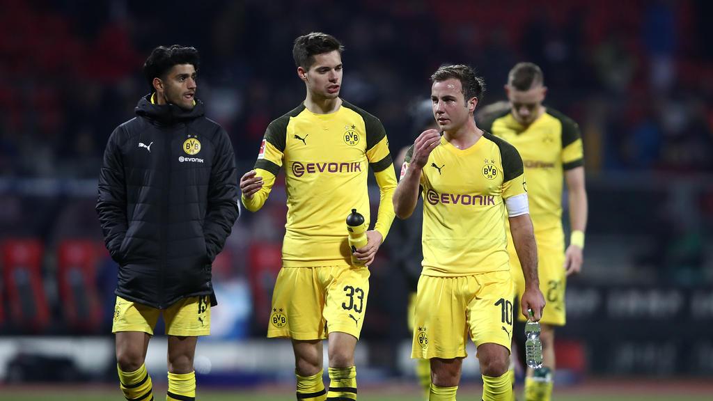 Die BVB-Stars um Julian Weigl (M.) und Mario Götze (r.) waren mit dem Remis gegen Nürnberg nicht zufrieden