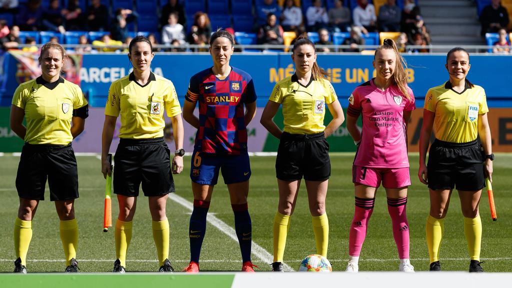 冠状病毒斗争的前线西班牙女足裁判
