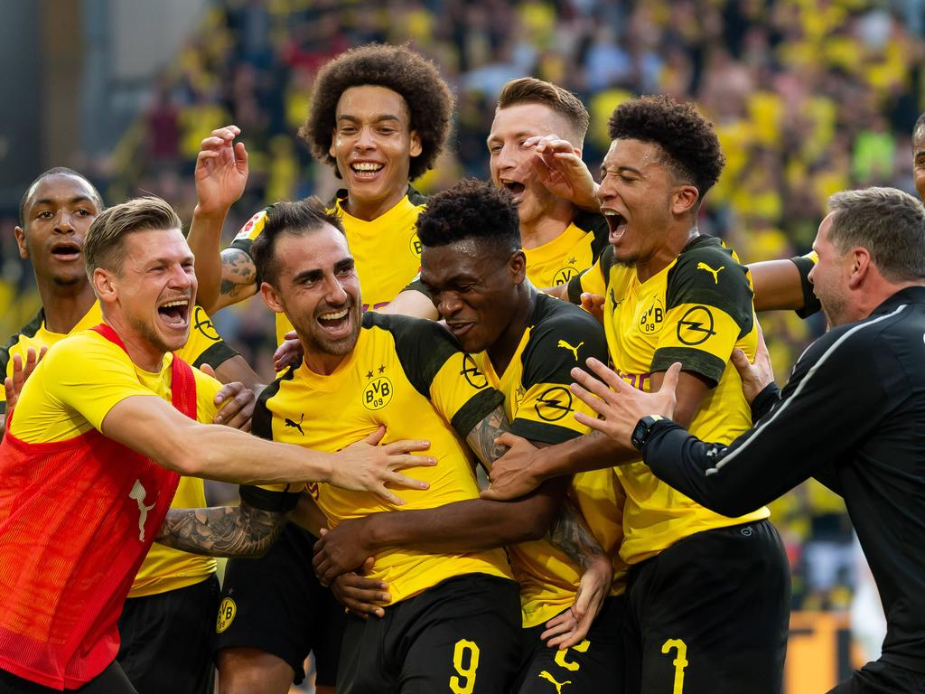 Substitute Paco Alcacer claimed a stunning hat-trick as his superb 96th- minute free-kick kept Borussia Dortmund top of the Bundesliga after a  dramatic 4-3 ... ca2f35fa9d