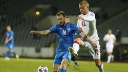 Sigurjonsson (l.) traf gegen Dänemark ins eigene Tor