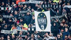 Aficionados de la Juventus en el estadio.