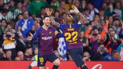 Messi se funde en un abrazo con Vidal en Sevilla. (Foto: Getty)
