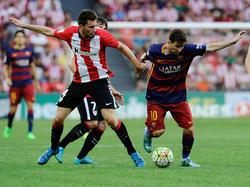 Aymeric Laporte (l.) im Duell mit Lionel Messi