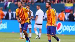 Neymar (l.) und Lionel Messi (r.) spielten schon gemeinsam beim FC Barcelona