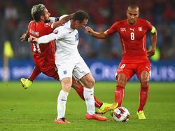 Rooney in der Zange