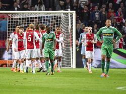 Ajax viert feest nadat de ploeg op voorsprong is gekomen tegen FC Dordrecht. Op de voorgrond balen Jeffry Fortes (l.) en Josimar Lima (r.). (01-11-2014)