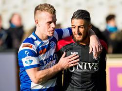 Lion Kaak (l.) en Caner Çavlan (r.) lopen een ereronde na afloop van het competitieduel De Graafschap - sc Heerenveen. (28-02-2016)