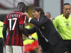 AC Milans Cristian Zapata (l.) mit Trainer Pippo Inzaghi