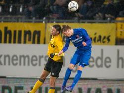 Hicham Faik en Hidde ter Avest (r.) vechten een luchtduel uit tijdens Roda JC - FC Twente. (13-02-2016)