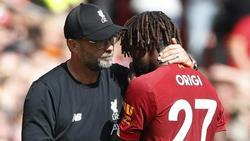 Liverpools Divock Origi (r. neben Jürgen Klopp) wurde in Genk rassistisch beleidigt