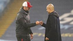 Jürgen Klopp (l.) hat Pep Guardiola zum Meistertitel gratuliert