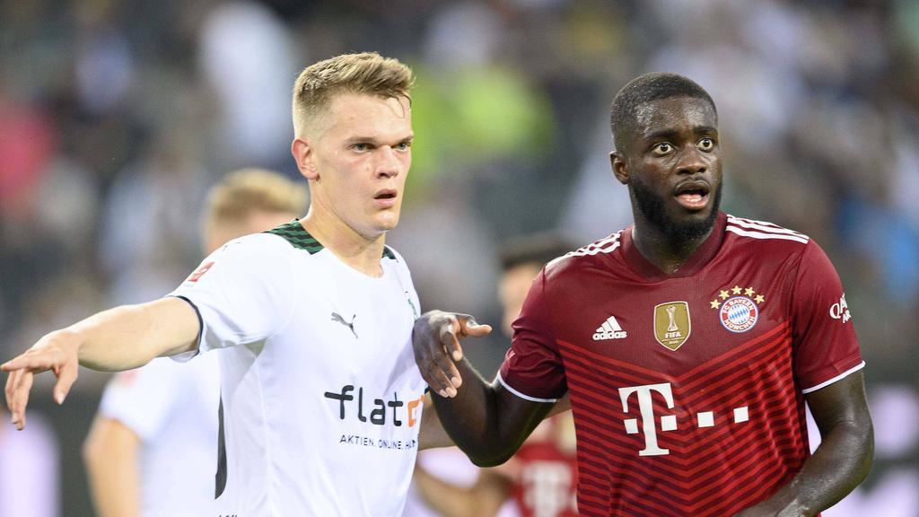 Gladbachs Ginter (l.) trifft in der zweiten Pokalrunde auf Dayot Upamecano und den FC Bayern
