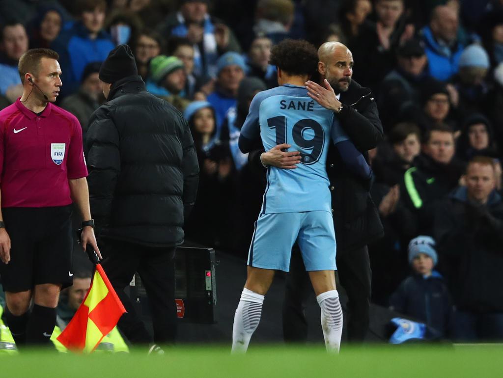Leroy Sané und City-Teammanager Pep Guardiola